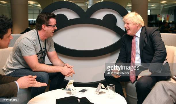 Britain's Foreign Minister Boris Johnson speaks with Iain Griffin CEO of SeatFrog and head of Tyro Fintech Hub Andrew CorbettJones during a visit to...