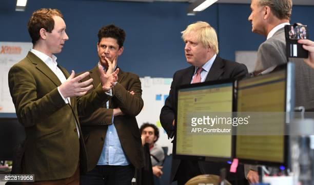 Britain's Foreign Minister Boris Johnson speaks with Neu Capital Director Edward Jones head of Tyro Fintech Hub Andrew CorbettJones and British...