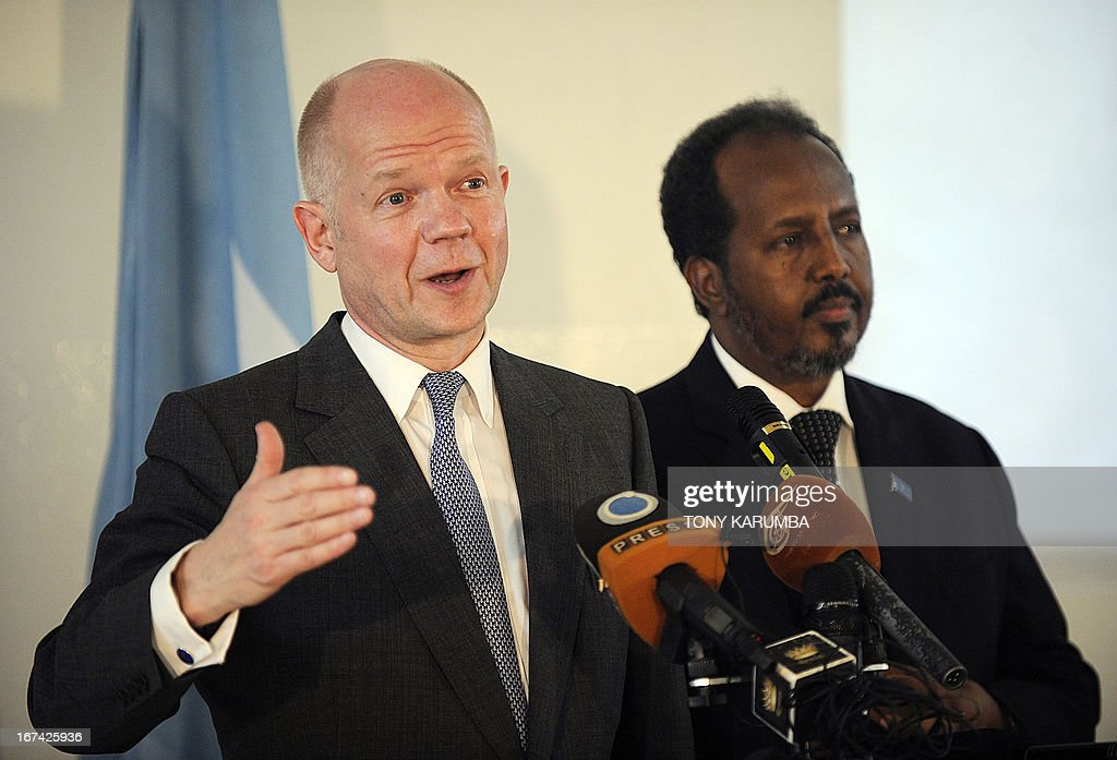 Britain's Foreign Minister William Hague addresses a press conference on April 25, 2013 in Mogadishu as Somalia President, Hassan Sheikh Mohamud listens after the re-opening of Britain's embassy in the city. Hague inaugurated the embassy in Mogadishu after a 22-year absence ,becoming the first EU nation to return to the conflict-torn capital. AFP PHOTO/Tony KARUMBA