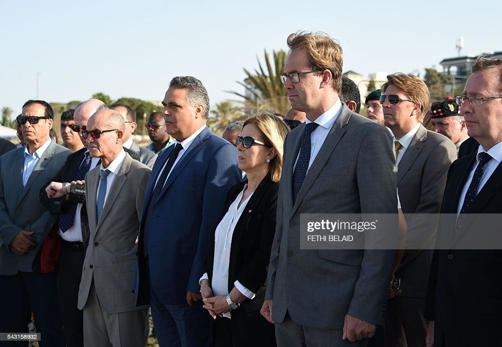 Britain's Foreign Office junior minister, Tobias Ellwood (C-R), and Tunisia's Tourism Minister, Salma Rekik Elloumi (C), attend on June 26, 2016, a ceremony in memory of those killed a year ago by a jihadist gunman in front of the Riu Imperial Marhaba Hotel in Port el Kantaoui, on the outskirts of Sousse south of the capital Tunis. Tourists fled in horror on June 26, 2015 as a Tunisian gunman pulled a Kalashnikov rifle from inside a furled beach umbrella and went on a shooting spree outside the five-star hotel. 30 Britons were among 38 foreign holidaymakers killed in the attack. / AFP / FETHI