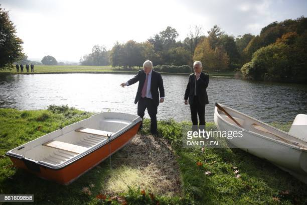Britain's Foreign Secretary Boris Johnson and Slovenia's State Secretary at the Ministry of Foreign Affairs Andrej Logar select a boat to put out on...