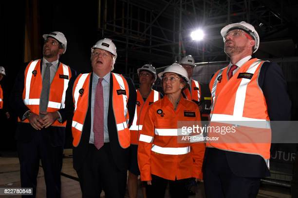 Britain's Foreign Secretary Boris Johnson chats with managing director of Laing O'Rourke Australia Cathal O'Rourke CEO of the Sydney Opera House...