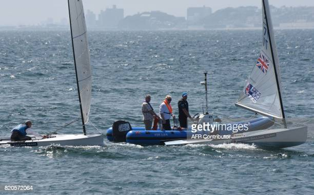 Britain's Foreign Secretary Boris Johnson inspects the British Olympic sailing team in Hayama Kanagawa prefecture on July 22 2017 Johnson is on a...