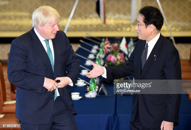 Britain's Foreign Secretary Boris Johnson is welcomed by his Japanese counterpart Fumio Kishida at the Iikura guesthouse in Tokyo on July 21 2017...