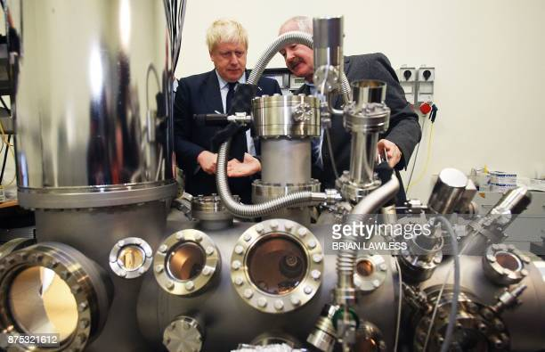 Britain's Foreign Secretary Boris Johnson looks at a scanning tunneling microscope with Professor John Boland during a visit to the Science Gallery...