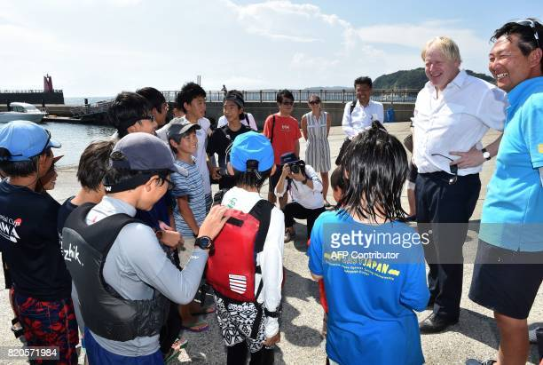 Britain's Foreign Secretary Boris Johnson meets with children of a yacht school during his inspection of the British Olympic sailing team in Hayama...