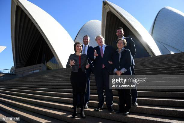 Britain's Foreign Secretary Boris Johnson poses for a photo with New South Wales state premier Gladys Berejiklian managing director of Laing O'Rourke...