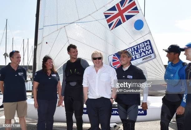 Britain's Foreign Secretary Boris Johnson poses for a photograph with members of the British Olympic sailing team in Hayama Kanagawa prefecture on...
