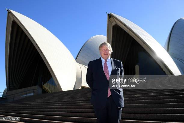 Britain's Foreign Secretary Boris Johnson poses on the stairs of the Sydney Opera House in Sydney on July 26 2017 Johnson is in Sydney to attend...