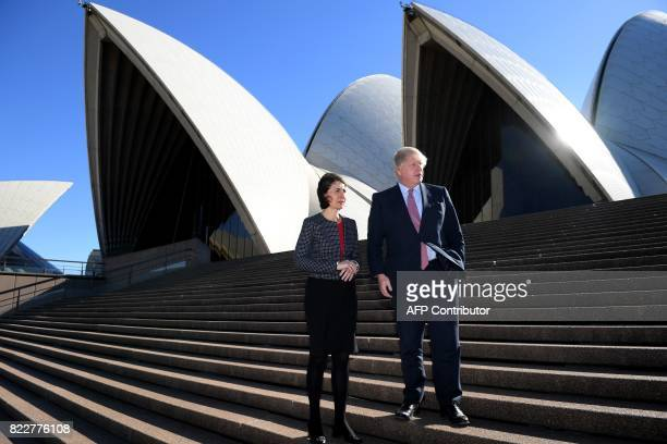 Britain's Foreign Secretary Boris Johnson poses with New South Wales state premier Gladys Berejiklian at the Sydney Opera House in Sydney on July 26...