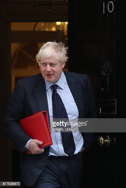 Britain's Foreign Secretary Boris Johnson reacts as he leaves 10 Downing Street in central London on November 21 2017 Senior British ministers have...