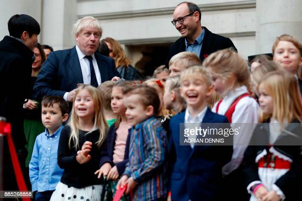Britain's Foreign Secretary Boris Johnson reacts as he stands with Norway's Foreign Secretary Ine Eriksen Soreide and children from a Norwegian...