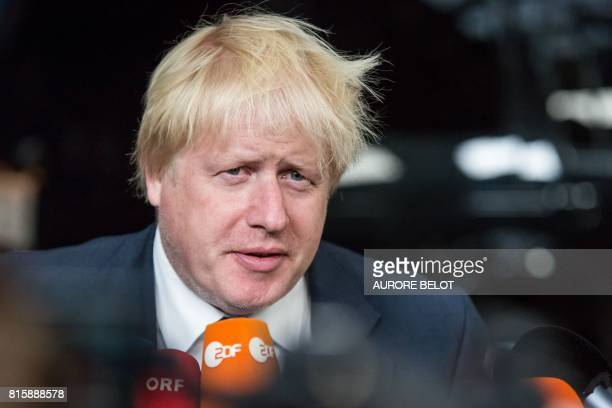 Britain's Foreign Secretary Boris Johnson speaks to the press upon his arrival at the European Council for the Foreign Affairs Council in Brussels on...