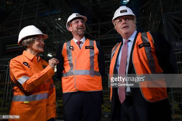 Britain's Foreign Secretary Boris Johnson speaks with CEO of the Sydney Opera House Louise Herron and Ben Nicol from Laing O'Rourke Australia as they...