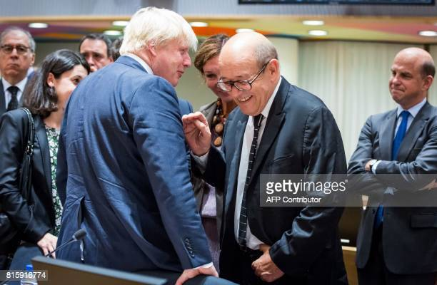 Britain's Foreign Secretary Boris Johnson talks to French Foreign Minister JeanYves Le Drian at the European Council for the Foreign Affairs Council...