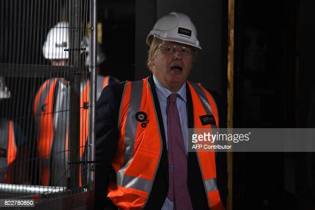Britain's Foreign Secretary Boris Johnson tour construction work underway at the Joan Sutherland Theatre at the Sydney Opera House on July 26 2017...