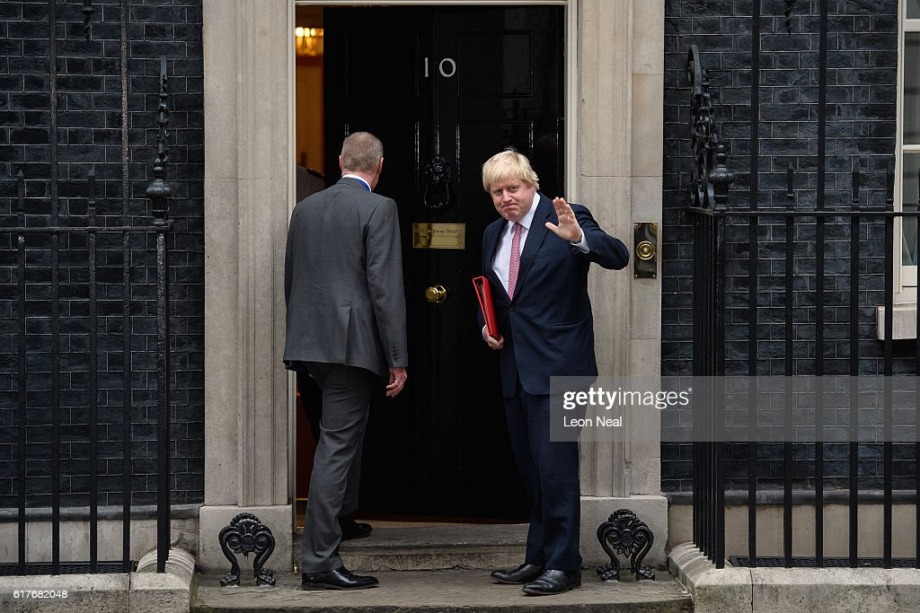 Britain's Foreign Secretary Boris Johnson (R) waves as he enters during a meeting between British Prime Minister Theresa May and the leaders of the three devolved governments at 10 Downing Street on October 24, 2016 in London, England. The Scottish and Welsh leaders want the devolved legislatures and Parliament to all have a vote on Brexit Secretary David Davis's approach.