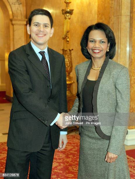 Britain's Foreign Secretary David Miliband shakes hands with US Secretary of State Condoleezza Rice after she arrived at Lancaster House in London