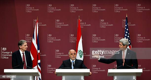 Britain's Foreign Secretary Philip Hammond Iraq's Prime Minister Haider alAbadi and US Secretary of State John Kerry attend a press conference at the...