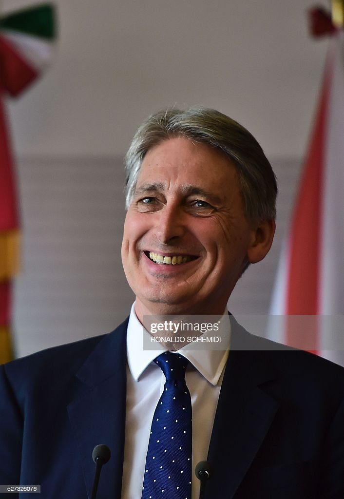 Britain's Foreign Secretary Philip Hammond takes part in a joint press conference with his Mexican counterpart Claudia Ruiz (out of frame) at the Foreign Affairs Secretariat, in Mexico City on May 2, 2016. / AFP / RONALDO
