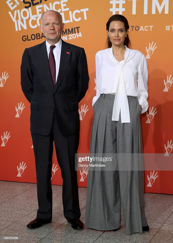 Britain's Foreign Secretary William Hague and US actress and UN special envoy Angelina Jolie attend the second day of the Global Summit to End Sexual Violence in Conflict on June 11, 2014 in London, England.