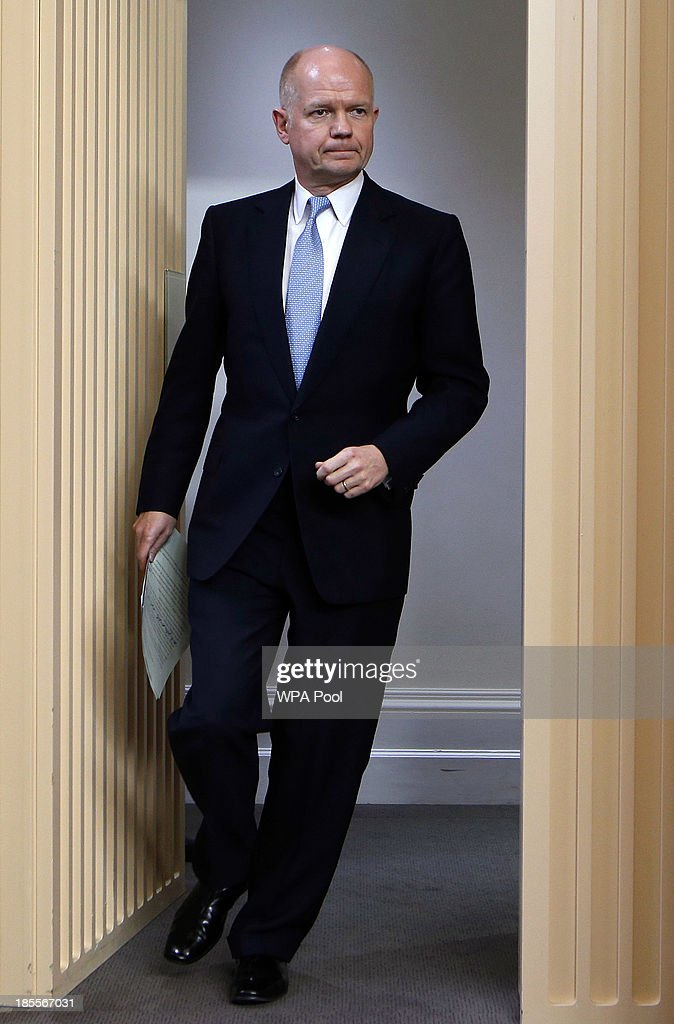 Britain's Foreign Secretary <a gi-track='captionPersonalityLinkClicked' href=/galleries/search?phrase=William+Hague&family=editorial&specificpeople=206295 ng-click='$event.stopPropagation()'>William Hague</a> arrives for a news conference at the Foreign and Commonwealth Office on October 22, 2013 in London, England. John Kerry attended a meeting, hosted by British Foreign Secretary <a gi-track='captionPersonalityLinkClicked' href=/galleries/search?phrase=William+Hague&family=editorial&specificpeople=206295 ng-click='$event.stopPropagation()'>William Hague</a> which brought together Foreign Ministers from the USA, Egypt, France, Germany, Italy, Jordan, Qatar, Saudi Arabia, Turkey and UAE as well as representatives from the Syrian National Coalition. Plans for talks to end the fighting in Syria were in jeopardy today after the opposition refused to attend unless President Bashar al-Assad is forced from power and a furious Saudi Arabia made clear it would no longer co-operate with the United States over the civil war.