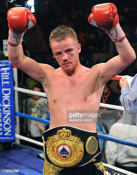 Britains Frankie Gavin celebrates after defeating Curtis Woodhouse during their WBO intercontinental welterweight championship boxing match at the...