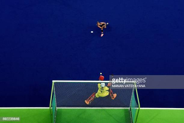 Britain's goalkeeper Maddie Hinch stops a shot at goal from Netherland's Maartje Paumen during the women's Gold medal hockey Netherlands vs Britain...