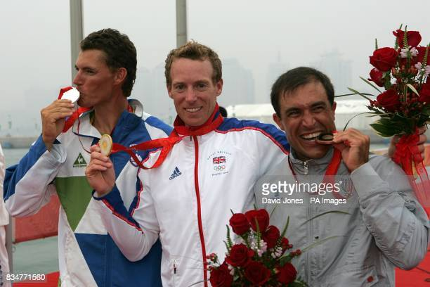 Britain's gold medalist Paul Goodison is flanked by silver medalist Slovenia's Vasilij Zbogar and bronze medalist Italy's Diego Romero