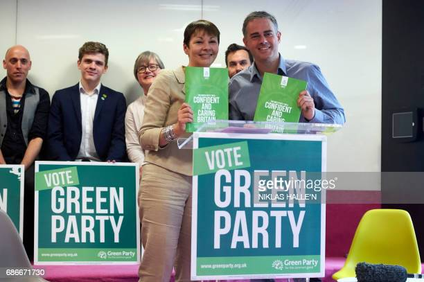 Britain's Green Party coleaders Caroline Lucas and Jonathan Bartley pose during the launch the Green Party's 'Green Guarantee' of key priorities for...
