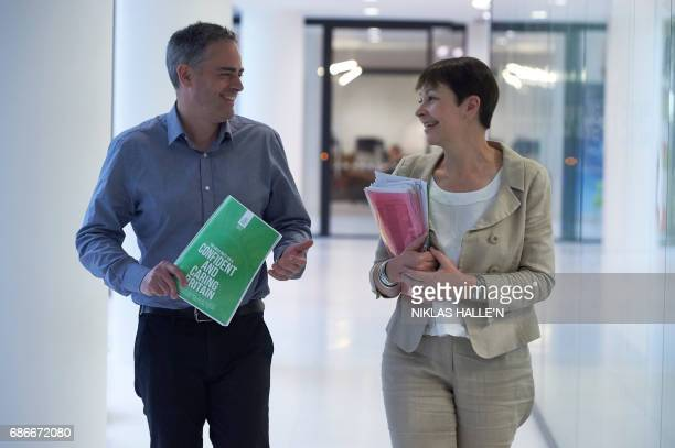 Britain's Green Party coleaders Caroline Lucas and Jonathan Bartley arrive for the launch of the Green Party's 'Green Guarantee' of key priorities...