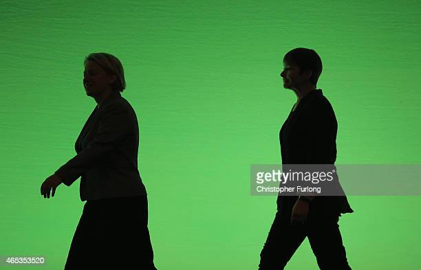 Britain's Green Party leader Natalie Bennett and Caroline Lucas MP arrive on stage at the start of the party's spring conference at the Arena...