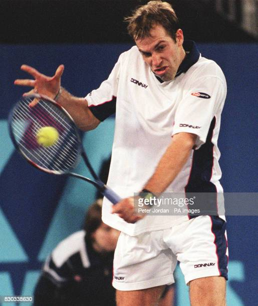 Britain's Greg Rusedski in action against Argentinian Mariano Zabaleta during their AXA Cup match at the London Arena today Rusedski claimed a...
