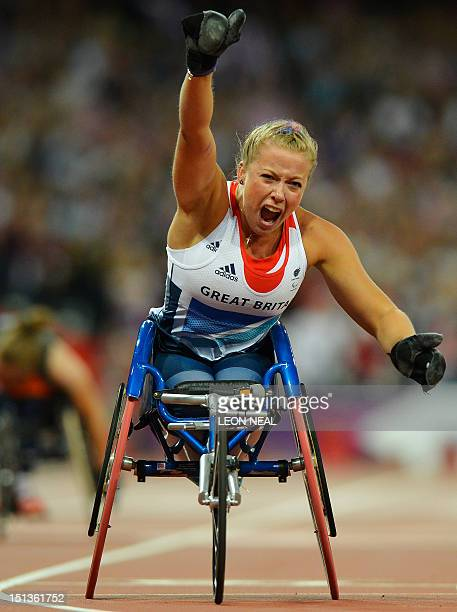 Britain's Hannah Cockroft celebrates taking the gold in the women's 200m T34 final during the athletics competition at the London 2012 Paralympic...