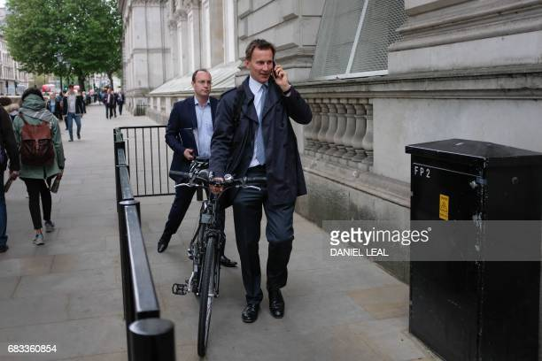 Britain's Health Secretary Jeremy Hunt arrives at Downing Street in central London on May 15 2017 ahead of a Cobra meeting Home Secretary Amber Rudd...