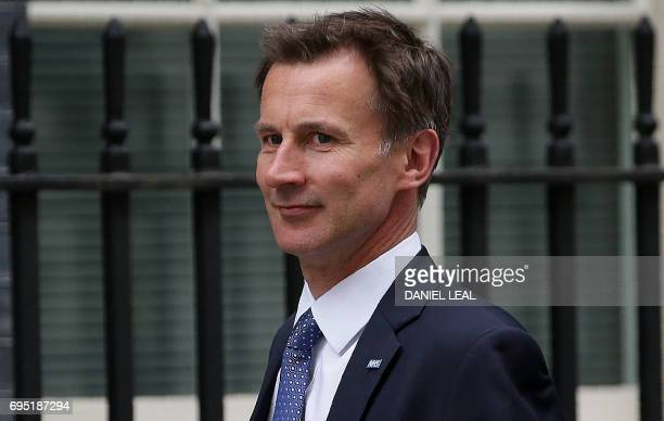 Britain's Health Secretary Jeremy Hunt arrives to attends a Cabinet meeting at 10 Downing Street in central London on June 12 following the June 8...