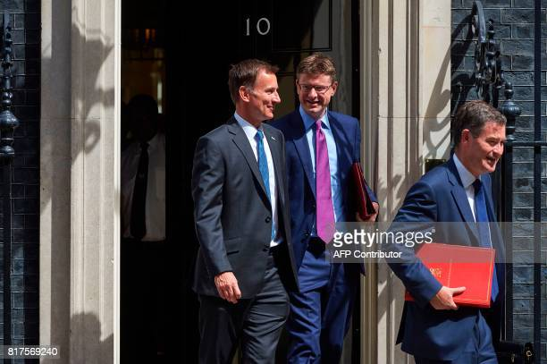 Britain's Health Secretary Jeremy Hunt Britain's Business Energy and Industrial Strategy Secretary Greg Clark and Britain's Work and Pensions...