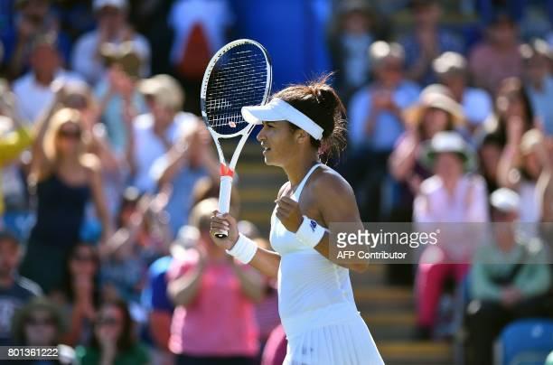 Britain's Heather Watson celebrates winning against Slovakia's Dominika Cibulkova during their women's singles second round tennis match at the ATP...