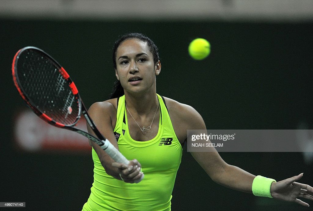 Britain's Heather Watson of Chennai Warriors plays a shot against Switzerland's Martina Hingis of Hyderabad Aces during the women's singles match at...