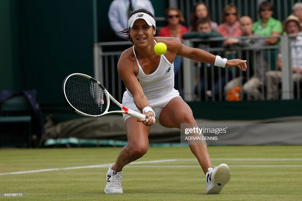 Britain's Heather Watson returns against Germany's Annika Beck during their women's singles first round match on the fourth day of the 2016 Wimbledon Championships at The All England Lawn Tennis Club in Wimbledon, southwest London, on June 30, 2016. / AFP / ADRIAN