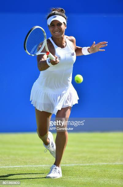 Britain's Heather Watson returns to Slovakia's Dominika Cibulkova during their women's singles second round tennis match at the ATP Aegon...
