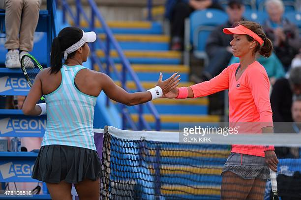 Britain's Heather Watson shakes hands with US player Varvara Lepchenko after winning their women's singles first round match at the WTA Eastbourne...