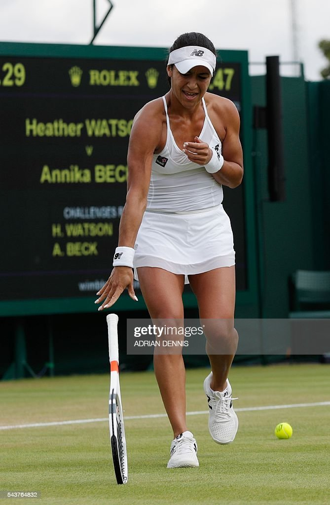 Britain's Heather Watson throws her racquet into the court after losing a game against Germany's Annika Beck during their women's singles first round match on the fourth day of the 2016 Wimbledon Championships at The All England Lawn Tennis Club in Wimbledon, southwest London, on June 30, 2016. / AFP / ADRIAN