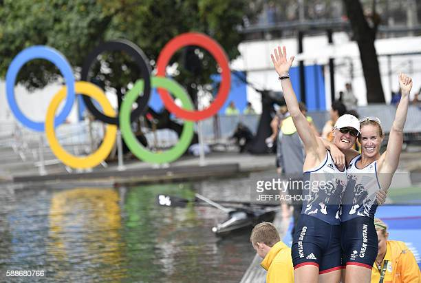 Britain's Helen Glover and Britain's Heather Stanning celebrate after winning the Women's Pair final rowing competition at the Lagoa stadium during...