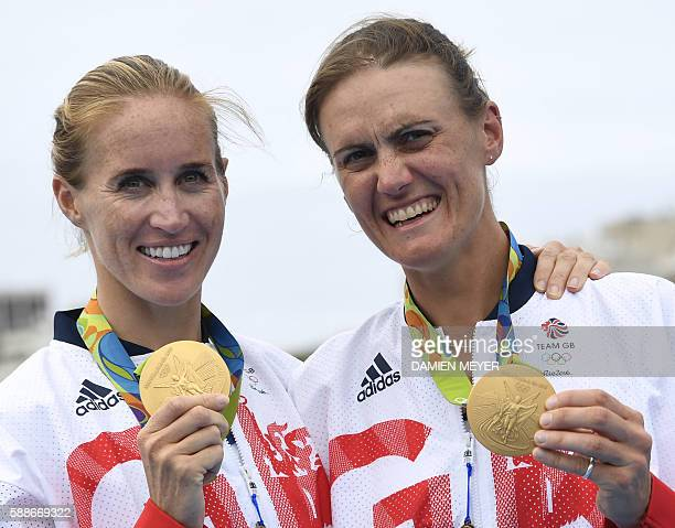 Britain's Helen Glover and Britain's Heather Stanning pose with their medals on the podium of the Women's Pair final rowing competition at the Lagoa...