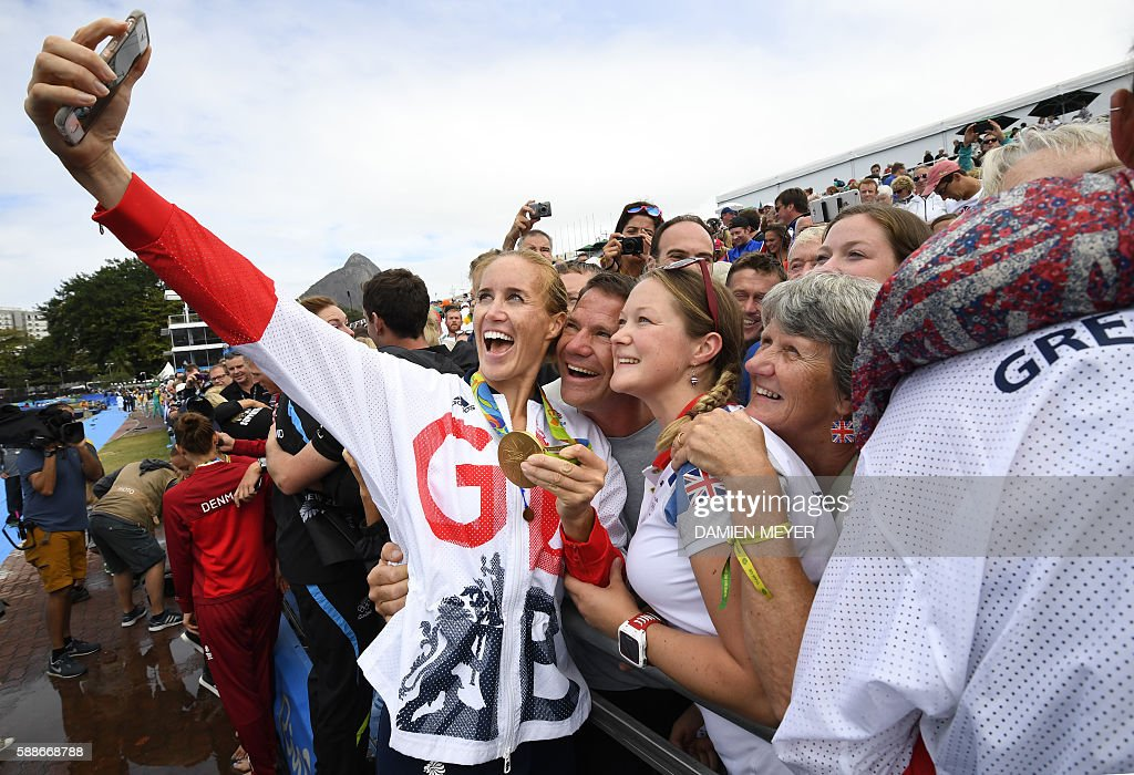 TOPSHOT Britain's Helen Glover takes a selfie photo after the podium of the Women's Pair final rowing competition at the Lagoa stadium during the Rio...