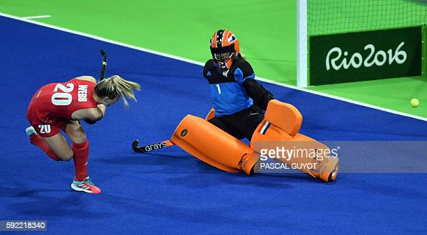 Britain's Hollie Webb scores a goal during the penalty shootout at the end of the women's Gold medal hockey Netherlands vs Britain match of the Rio...