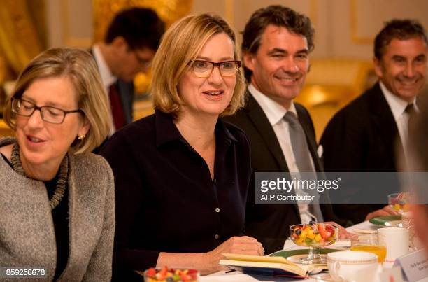 Britain's Home Secretary Amber Rudd talks with attendees inclunding Parliamentary Under Secretary of State for Crime Safeguarding and Vulnerability...