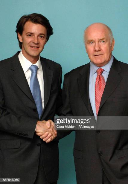 Britain's Home Secretary John Reid shakes hands with France's Interior Minister Francois Baroin as they meet for the first time in the Home Office on...