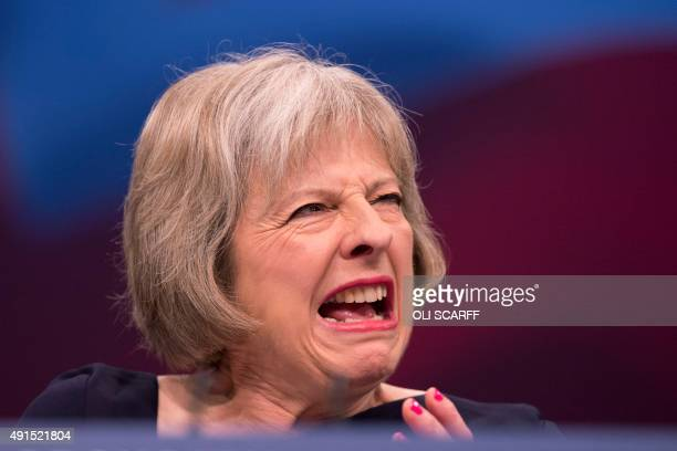 Britain's Home Secretary Theresa May addresses delegates on the third day of the annual Conservative party conference in Manchester north west...